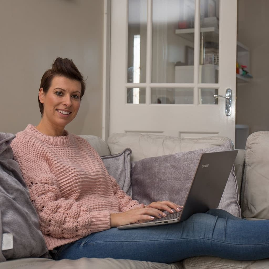 Catherine Tuckwell Personal Brand Photography session relaxing indoors with laptop lifestyle coach