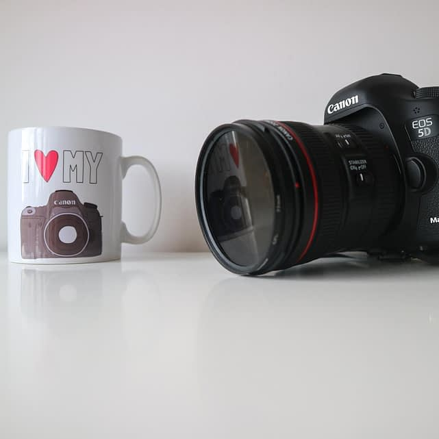 Catherine Tuckwell Brand photography white coffee mug with Canon SLR camera
