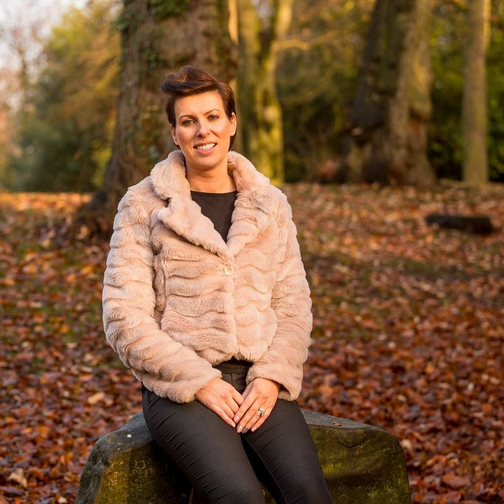 Catherine Tuckwell Personal Brand Photography session outdoors in park with autumn leaves