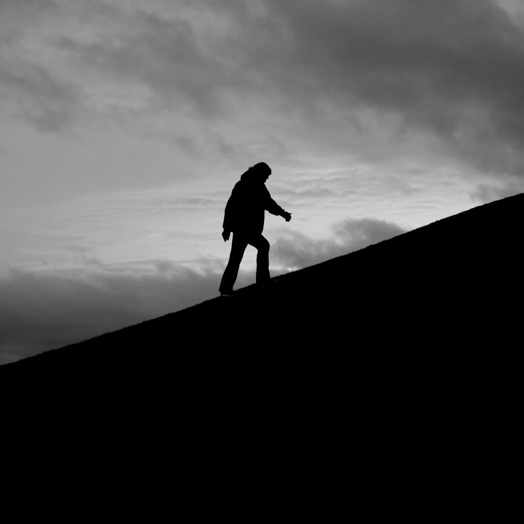 Catherine Tuckwell Personal Brand Photography session outdoors climbing hill black and white silhouette